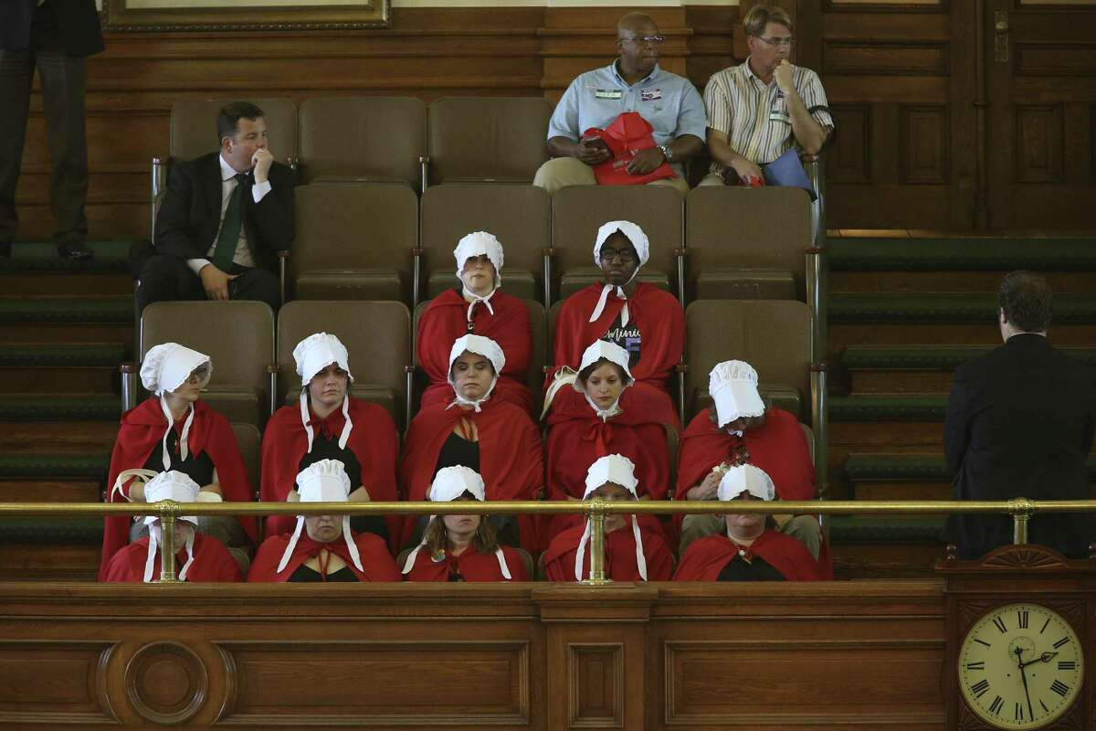 Handmaids show up for the regular session of the Texas Senate March 20, 2017. Though the U.S. Senate recently rejected a bill banning abortions after 20 weeks, Texas is among the states that have enacted such a measure.