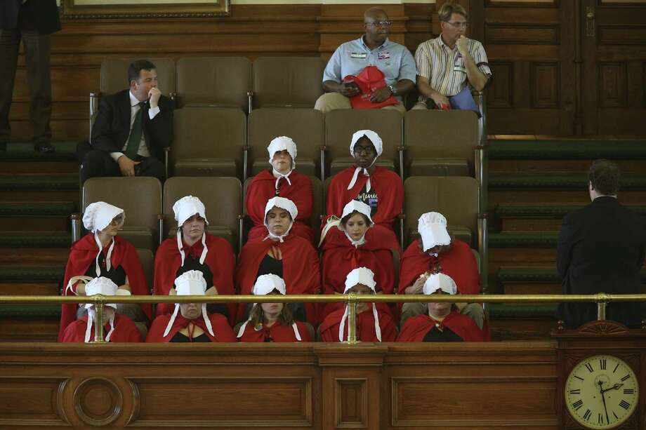 Handmaids show up for the regular session of the Texas Senate, Monday, March 20, 2017. The Senate was considering a couple of anti-abortion bills during Monday's session. Photo: JERRY LARA / San Antonio Express-News / © 2017 San Antonio Express-News