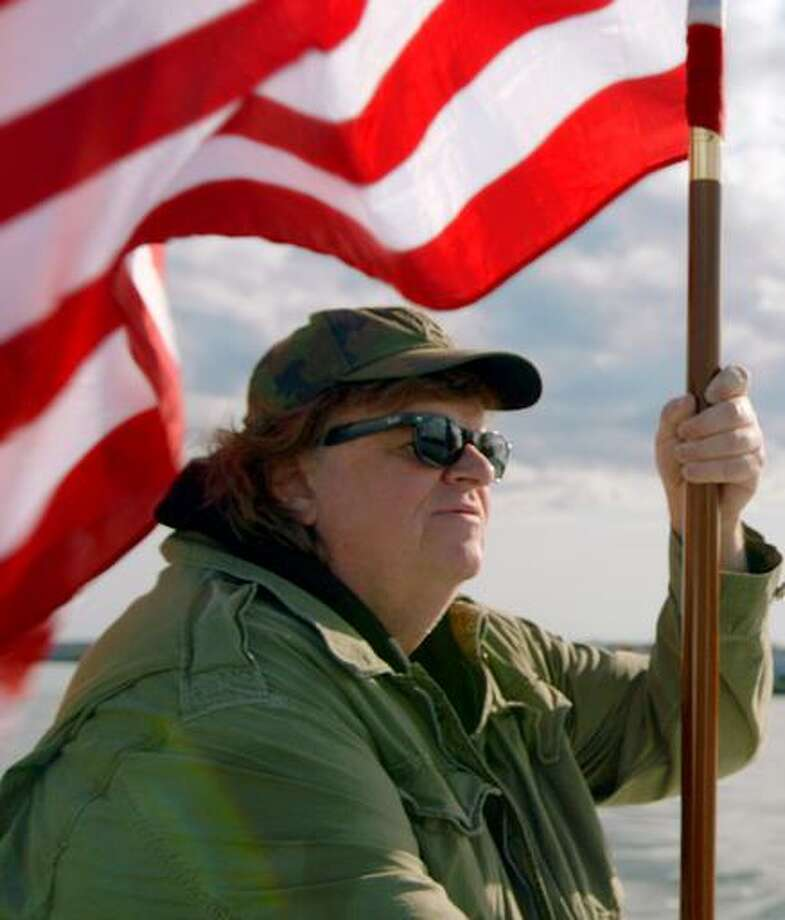 Filmmaker Michael Moore, on elitists making fun of Trump supporters: Guess what a lot of people in Michigan, Ohio, Wisconsin and Pennsylvania like to wear when they're running errands, or jogging around their neighborhood, or picking up the kids from school? Yep. Baseball caps. Photo: Big World Pictures /Big World Pictures / Big World Pictures