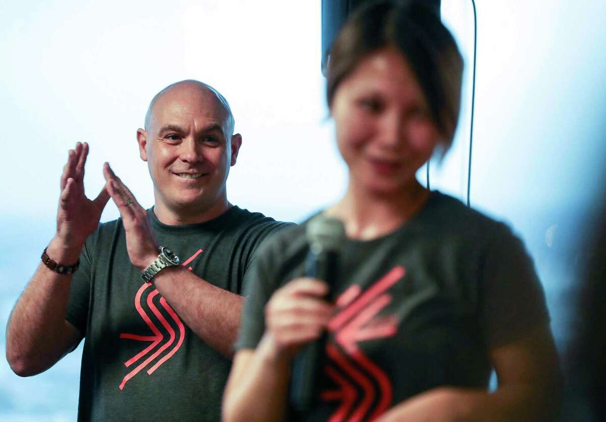 John Reale, left, CEO and co-founder of accelerator Station Houston, applauds as fellow co-founder Grace Rodriguez speaks during a one-year anniversary party earlier this month.