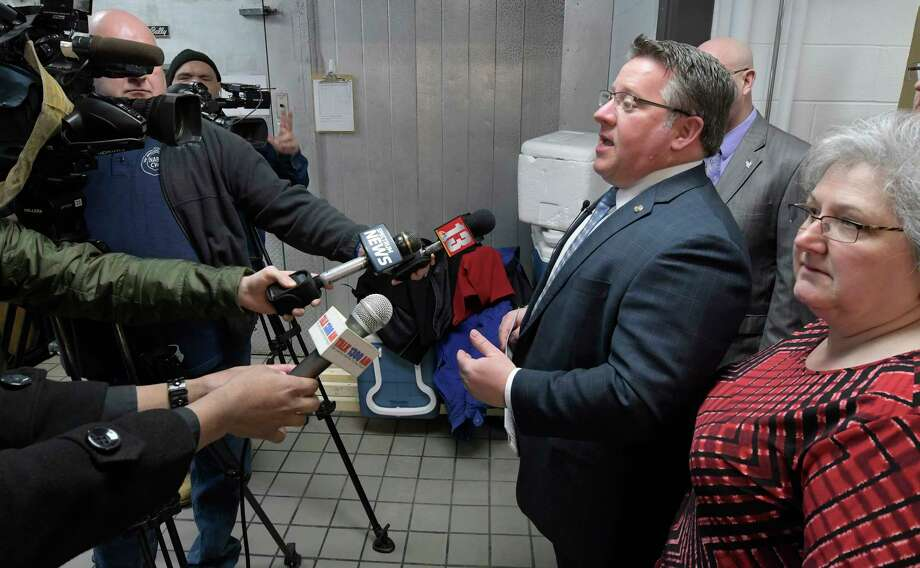 Albany County Executive Dan McCoy addresses the effect of President Trump's budget will have on seniors both locally and nationally at the Meals on Wheels kitchen Monday March 20, 2017 in Albany, N.Y. He is joined by local elected officials and Monika Boeckmann, executive director of Senior Services of Albany, right. (Skip Dickstein/Times Union) Photo: SKIP DICKSTEIN / 20040007A