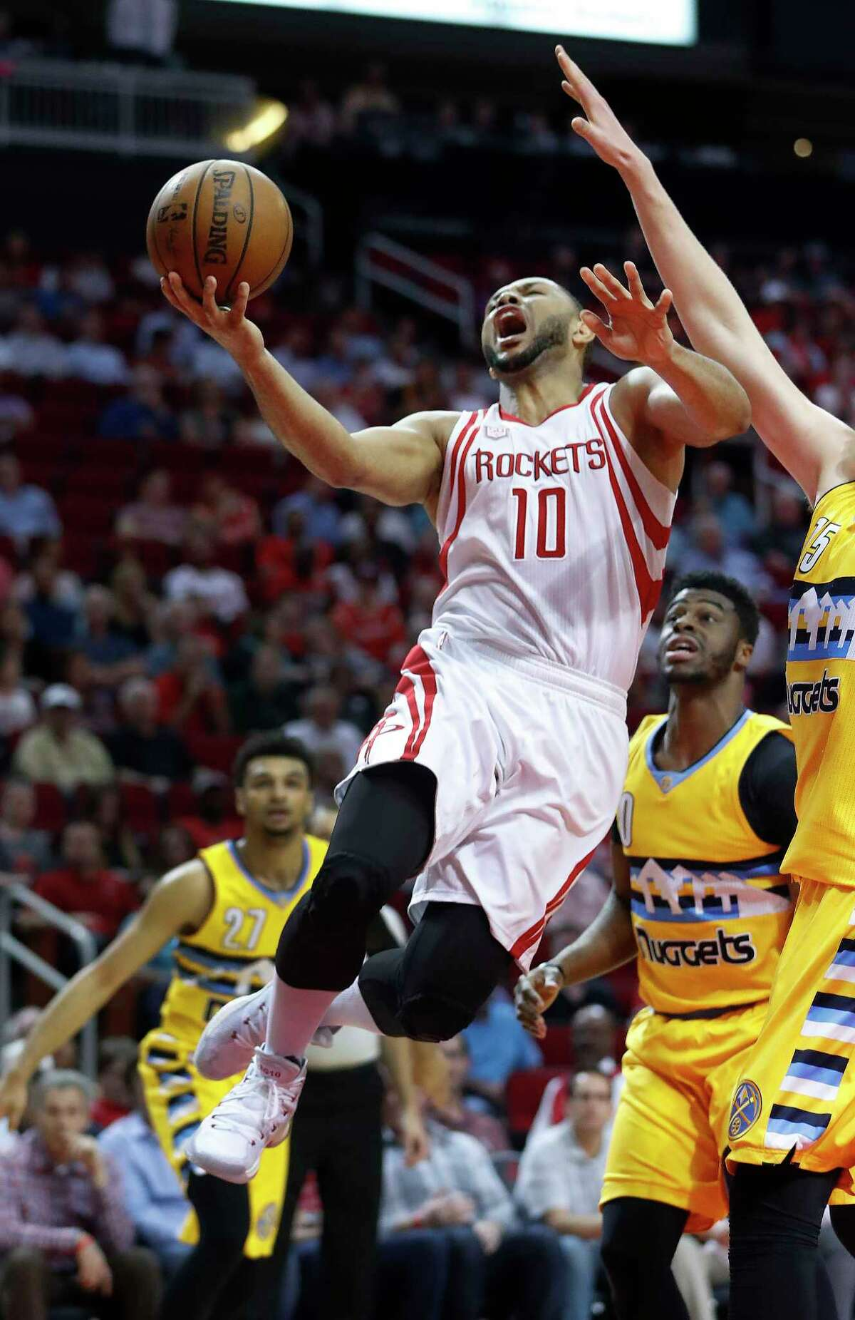 Houston Rockets guard Eric Gordon (10) drives to the basket against Denver Nuggets defense during the first half of an NBA basketball game, Monday, March 20, 2017, at the Toyota Center, in Houston.