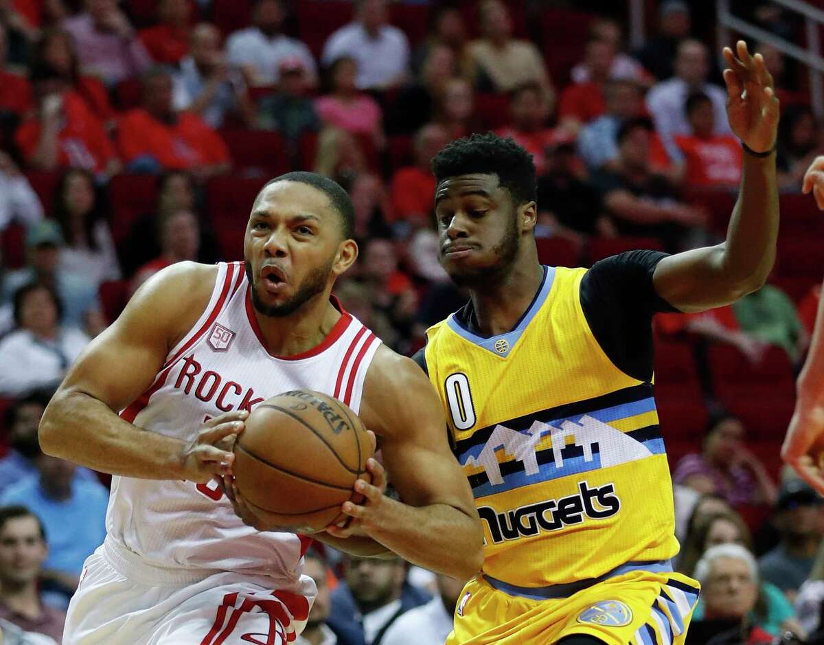 Houston Rockets guard Eric Gordon (10) drives to the basket against Denver Nuggets guard Emmanuel Mudiay (0) during the first half of an NBA basketball game, Monday, March 20, 2017, at the Toyota Center, in Houston.