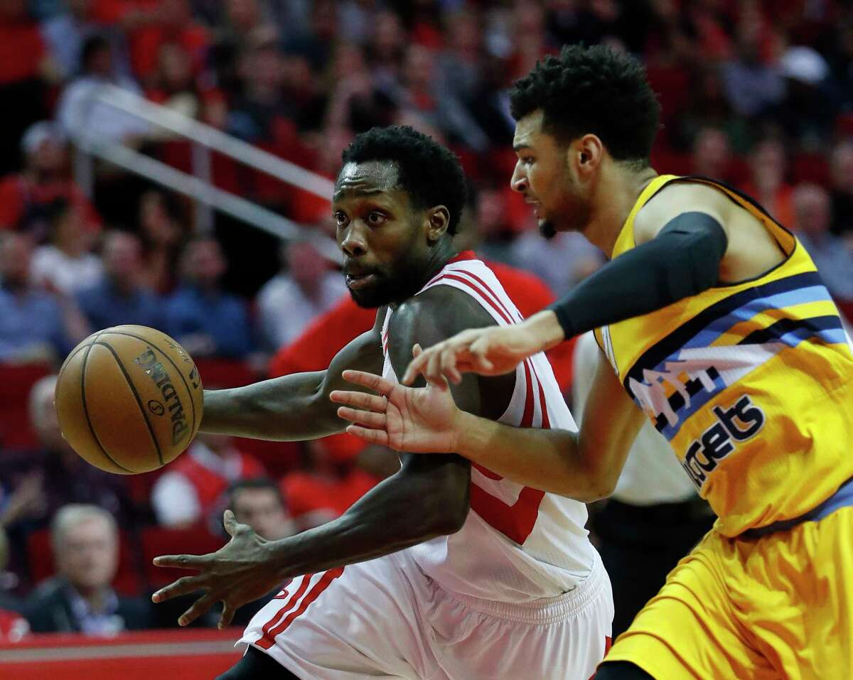 Houston Rockets guard Patrick Beverley (2) drives around Denver Nuggets guard Jamal Murray (27) during the first half of an NBA basketball game, Monday, March 20, 2017, at the Toyota Center, in Houston.