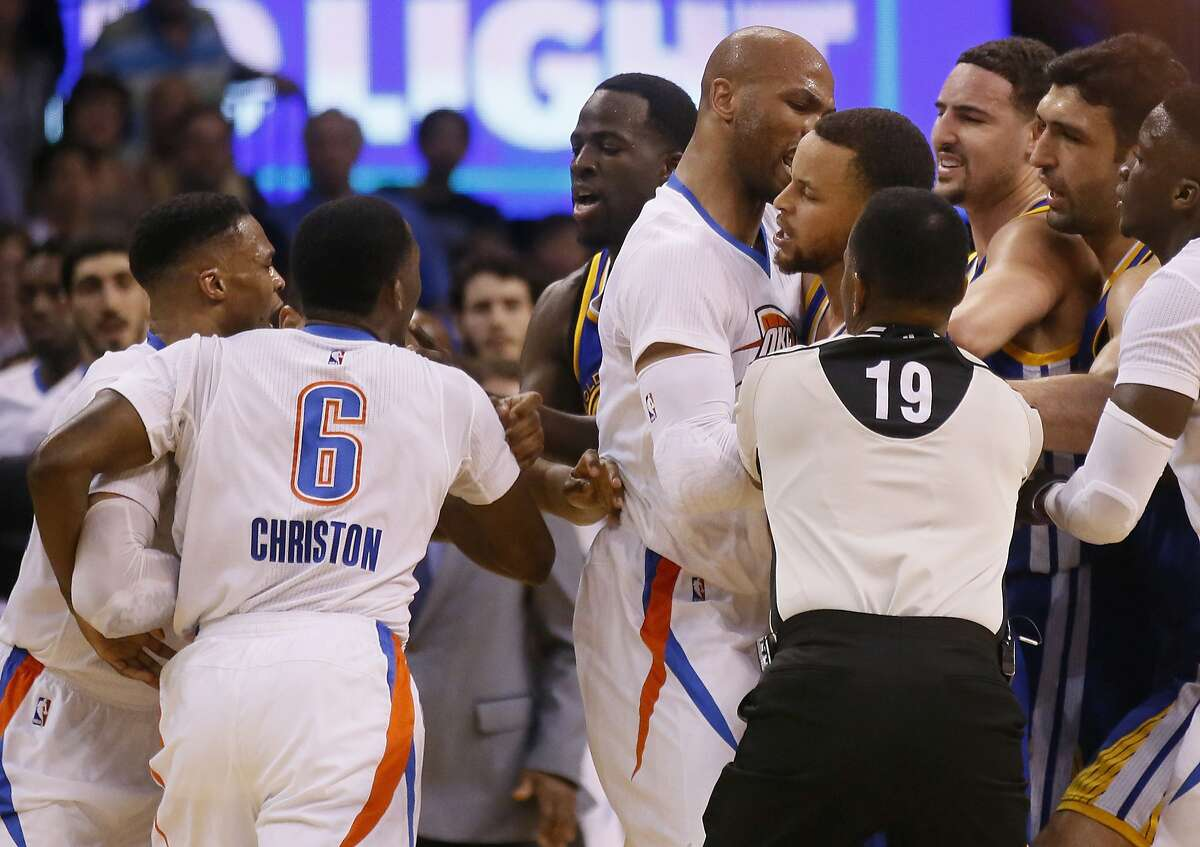 From left, Oklahoma City Thunder guard Russell Westbrook and guard Semaj Christon (6), Golden State Warriors forward Draymond Green, Thunder forward Taj Gibson, and Warriors guards Stephen Curry and Klay Thompson get into a tussle during the second quarter of an NBA basketball game in Oklahoma City, Monday, March 20, 2017. At right are Warriors center Zaza Pachulia and Thunder guard Victor Oladipo. (AP Photo/Sue Ogrocki)