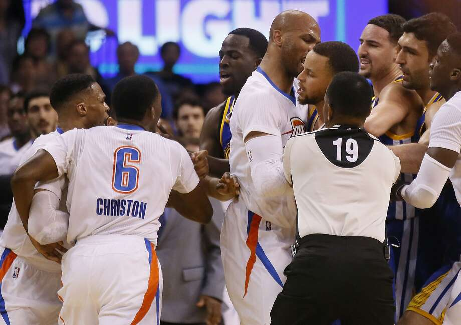 From left, Oklahoma City Thunder guard Russell Westbrook and guard Semaj Christon (6), Golden State Warriors forward Draymond Green, Thunder forward Taj Gibson, and Warriors guards Stephen Curry and Klay Thompson get into a tussle during the second quarter of an NBA basketball game in Oklahoma City, Monday, March 20, 2017. At right are Warriors center Zaza Pachulia and Thunder guard Victor Oladipo. (AP Photo/Sue Ogrocki) Photo: Sue Ogrocki, Associated Press
