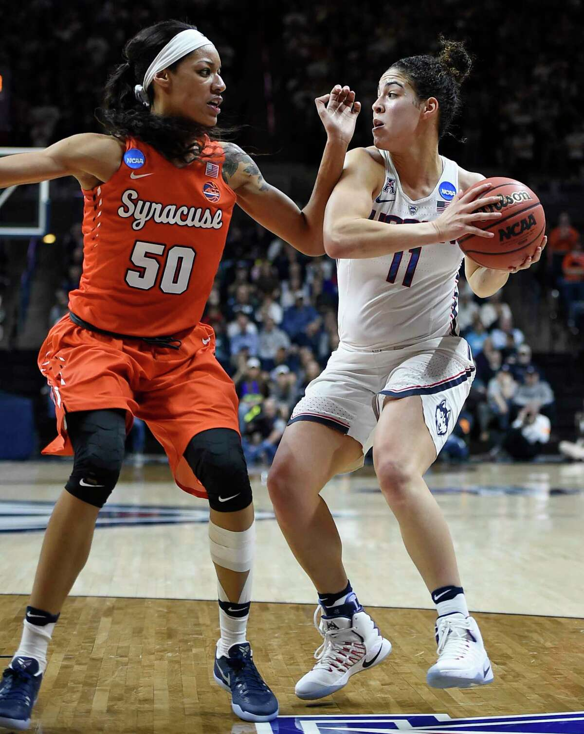 Connecticut's Kia Nurse keeps the ball from Syracuse's Briana Day, left, during the second half of a second-round game in the NCAA women's college basketball tournament, Monday, March 20, 2017, in Storrs, Conn. (AP Photo/Jessica Hill) ORG XMIT: CTJH106