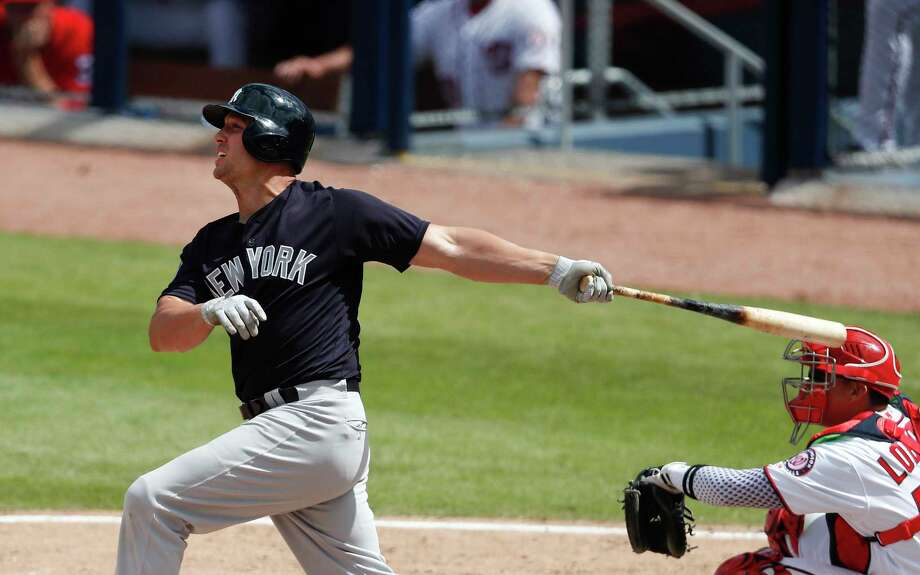 New York Yankees' Matt Holliday (17) follows through on a two-run homer as Washington Nationals catcher Jose Lobaton (59) looks on in fifth inning of a spring training baseball game Monday, March 20, 2017, in West Palm Beach, Fla. (AP Photo/John Bazemore) ORG XMIT: FLJB106 Photo: John Bazemore / Copyright 2017 The Associated Press. All rights reserved.