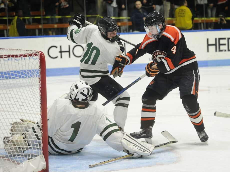 Ridgefield's Landon Byers tries to put the puck past Northwest Catholic goalie Cal Skwara in the opening period of the boys Division 1 Ice Hockey Championship game at Ingalls Rink in New Haven Conn. on Monday, March 30 , 2017. Photo: Brian A. Pounds / Hearst Connecticut Media / Connecticut Post