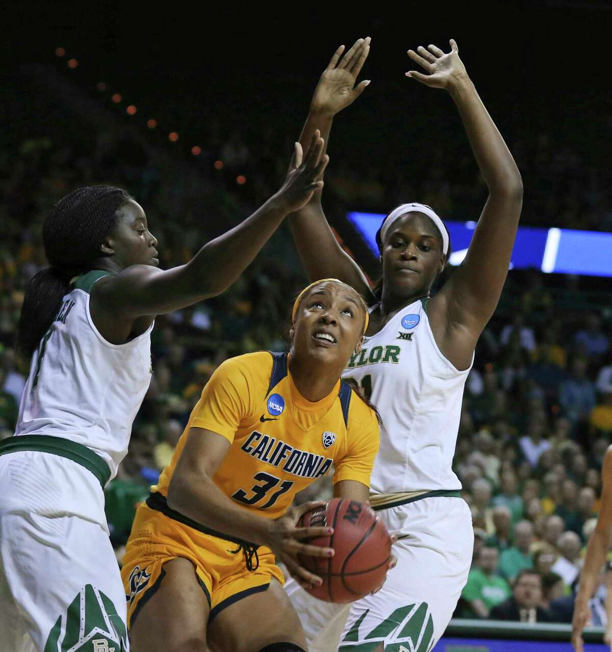 California forward Kristine Anigwe, center, is guarded by Baylor forward Dekeiya Cohen, left, and center Kalani Brown during the first half of a second-round game in the NCAA women's college basketball tournament in Waco, Texas, Monday, March 20, 2017.