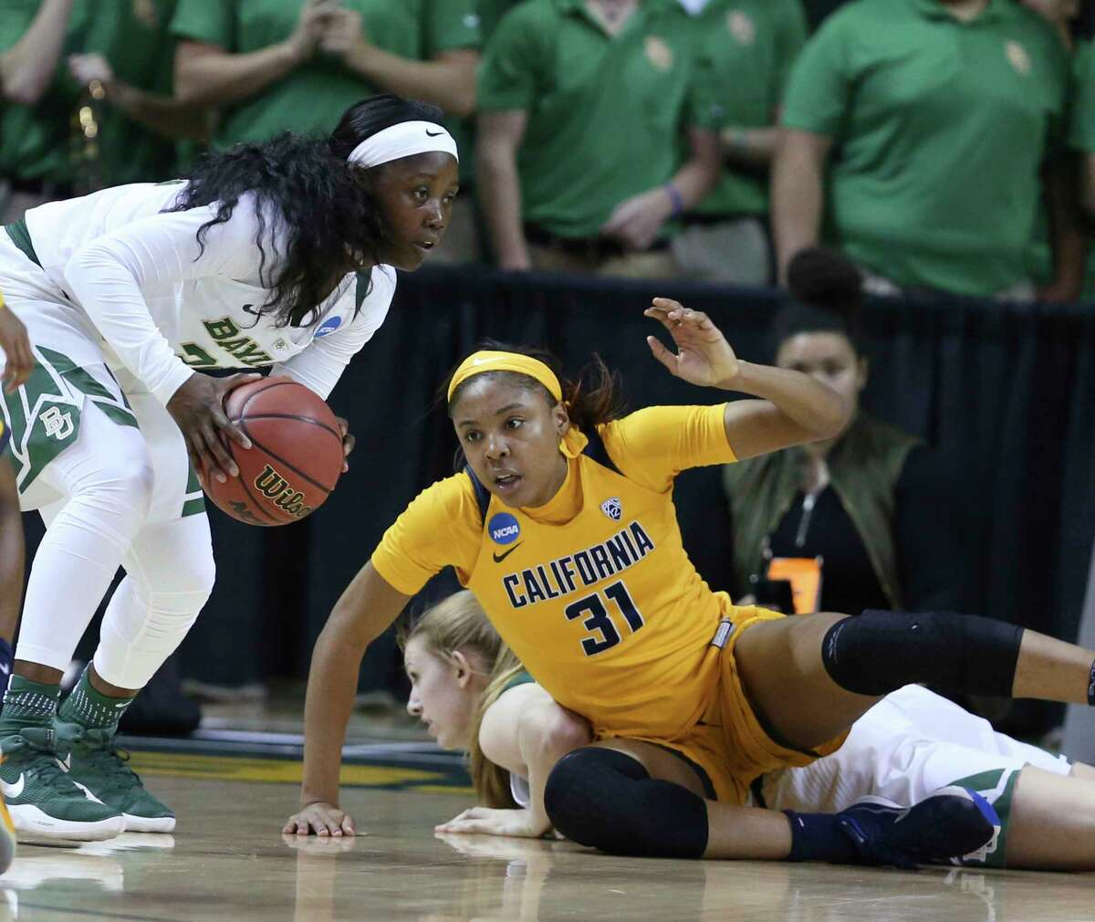 Baylor guard Alexis Jones, left, grabs a loose ball next to California forward Kristine Anigwe during the first half of a second-round game in the NCAA women's college basketball tournament in Waco, Texas, Monday, March 20, 2017.