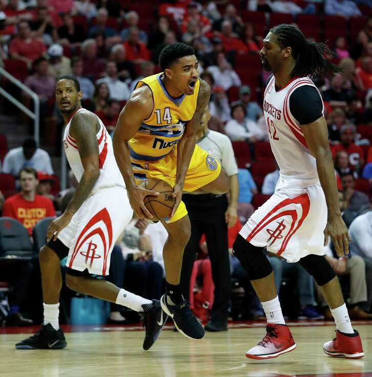 Houston Rockets forward Troy Williams (14) screams as he tried to maintain control of the ball against Houston Rockets center Nene Hilario (42) during the second half Monday, March 20, 2017, at the Toyota Center, in Houston.
