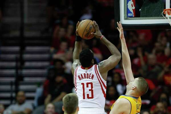 CAPTION CORRECTION: Houston Rockets guard James Harden (13) goes up for a basket during the second half Monday, March 20, 2017, at the Toyota Center, in Houston.