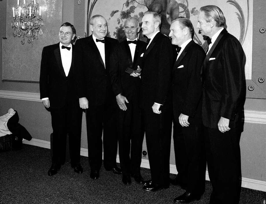 FILE - In this Nov. 28, 1967, file photo, the five Rockefeller Brothers pose for photos in New York as they gather to receive gold medals from the National Institute of social sciences. From left are: David Rockefeller, President of the Chase Manhattan Bank; Winthrop Rockefeller, Governor of Arkansas; Frank Pace, President of the NISS; John D. Rockefeller 3rd, Chairman of the Rockefeller Foundation; Nelson Rockefeller, Governor of New York; and Laurence Rockefeller, a conservation adviser to President Johnson. David Rockefeller, the billionaire philanthropist who was the last of his generation in the famously philanthropic Rockefeller family died. David Rockefeller was 101 years old. (AP Photo/File) Photo: STF / Copyright 2017 The Associated Press. All rights reserved.