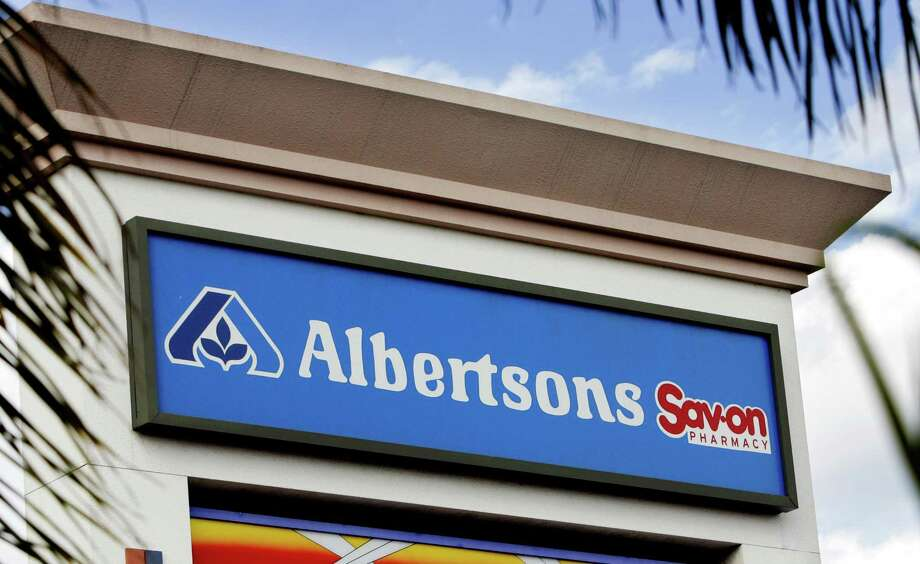 A sign outside an Albertson's supermarket with a Sav-on pharmacy on site is seen in the Van Nuys  section of Los Angeles, Tuesday, March 7, 2006. Albertson's Inc., the nation's second-largest supermarket chain, said Tuesday its profit in the fourth quarter declined 17 percent, weighed down by charges. For the quarter ended Feb. 2, net income fell to $162 million, or 43 cents per share, from $194 million, or 52 cents per share, a year earlier. Earnings in the latest quarter included 9 cents per share in charges, compared with 2 cents per share in the year-ago period. (AP Photo/Reed Saxon) Photo: REED SAXON, STF / AP