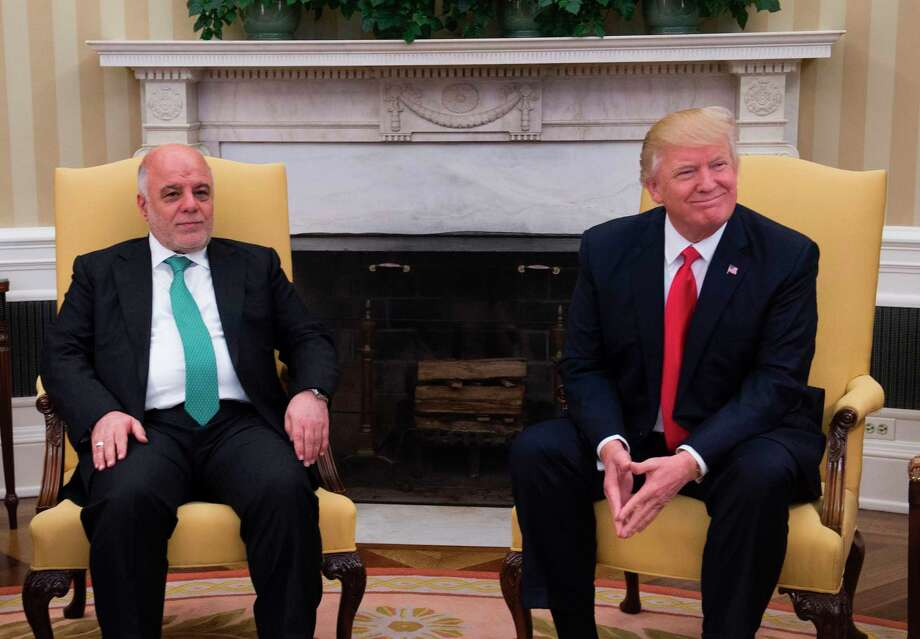 US President Donald Trump meets with Iraqi Prime Minister Haider Al-Abadi in the Oval Office in the White House on March 20, 2017, in Washington, DC.   / AFP PHOTO / MOLLY RILEYMOLLY RILEY/AFP/Getty Images ORG XMIT: US Presid Photo: MOLLY RILEY / AFP or licensors