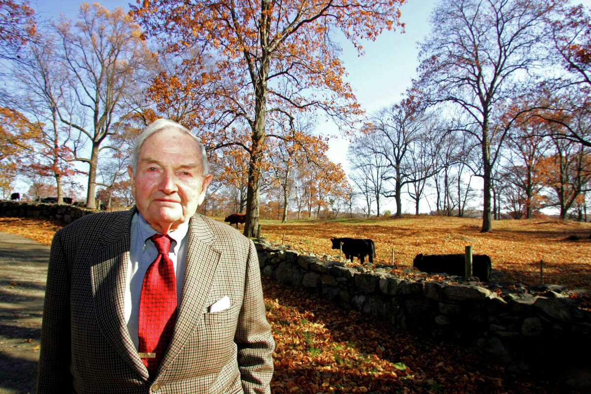 FILE-- David Rockefeller at his family?'s Pocantico Hills estate in Westchester County, N.Y., Nov. 12, 2005. Rockefeller, the banker and philanthropist with the fabled family name who controlled Chase Manhattan bank for more than a decade and wielded vast influence around the world even longer as he spread the gospel of American capitalism, died on March 20, 2017, at his home in Pocantico Hills. He was 101. (Suzanne DeChillo/The New York Times) ORG XMIT: XNYT148