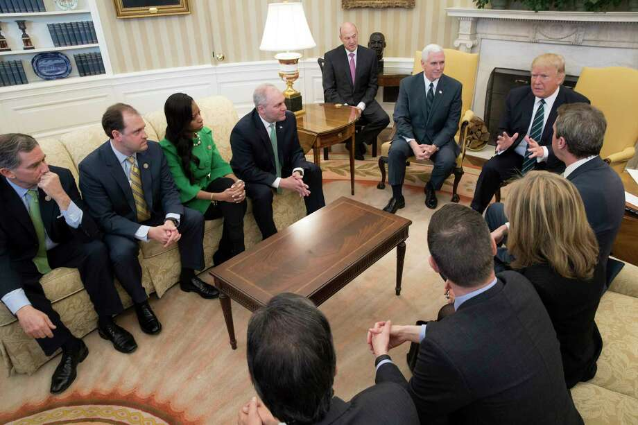 President Donald Trump and Vice President Mike Pence meet with members of the Republican Study Committee to talk about the proposed American Health Care Act, in the Oval Office of the White House, in Washington, March 17, 2017. (Stephen Crowley/The New York Times) ORG XMIT: XNYT15 Photo: STEPHEN CROWLEY / NYTNS