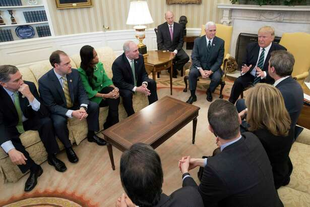 President Donald Trump and Vice President Mike Pence meet with members of the Republican Study Committee to talk about the proposed American Health Care Act, in the Oval Office of the White House, in Washington, March 17, 2017. (Stephen Crowley/The New York Times) ORG XMIT: XNYT15