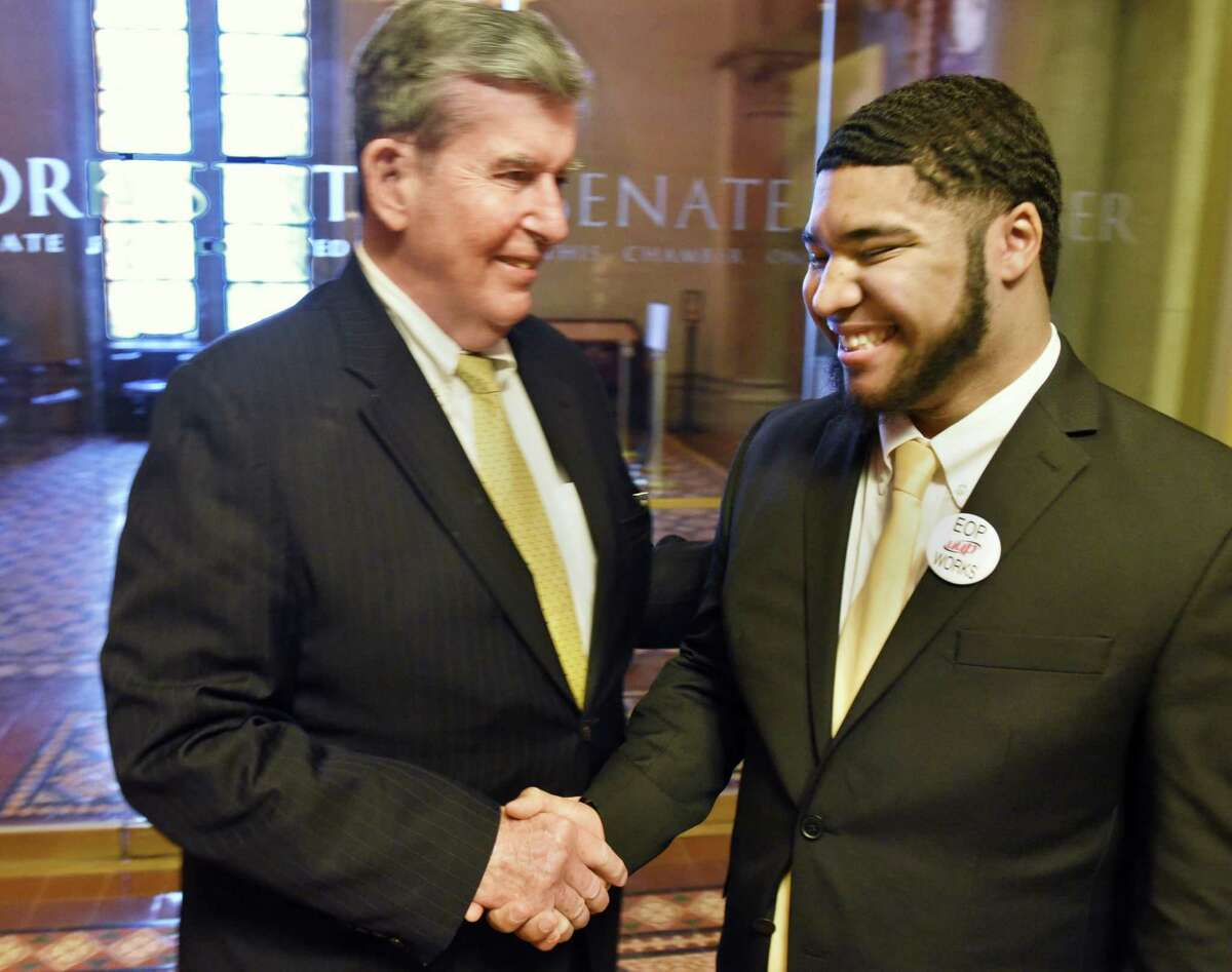 SUNY student Moises Urena, right, meets Senator Neil Breslin during a visit to the Capitol to lobby for increased state aid Wednesday March 8, 2017 in Albany, NY. (John Carl D'Annibale / Times Union)