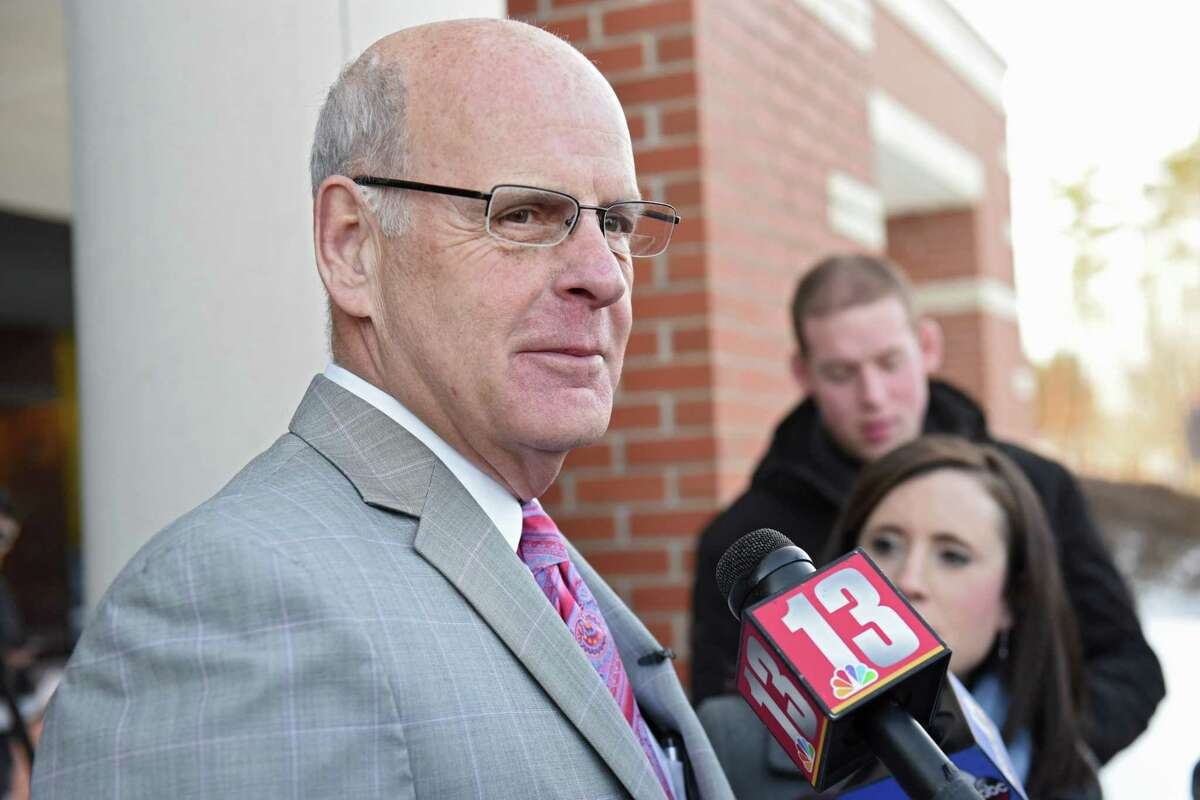 Troy police officer Kevin P. McKenna's attorney Stephen Coffey talks to the press as he leaves Colonie Town Court following McKenna's arraignment on Monday, March 20, 2017 in Colonie, N.Y. McKenna is charged with drunken driving and he's accused of crashing into a Colonie police van while off-duty. ( Lori Van Buren / Times Union)
