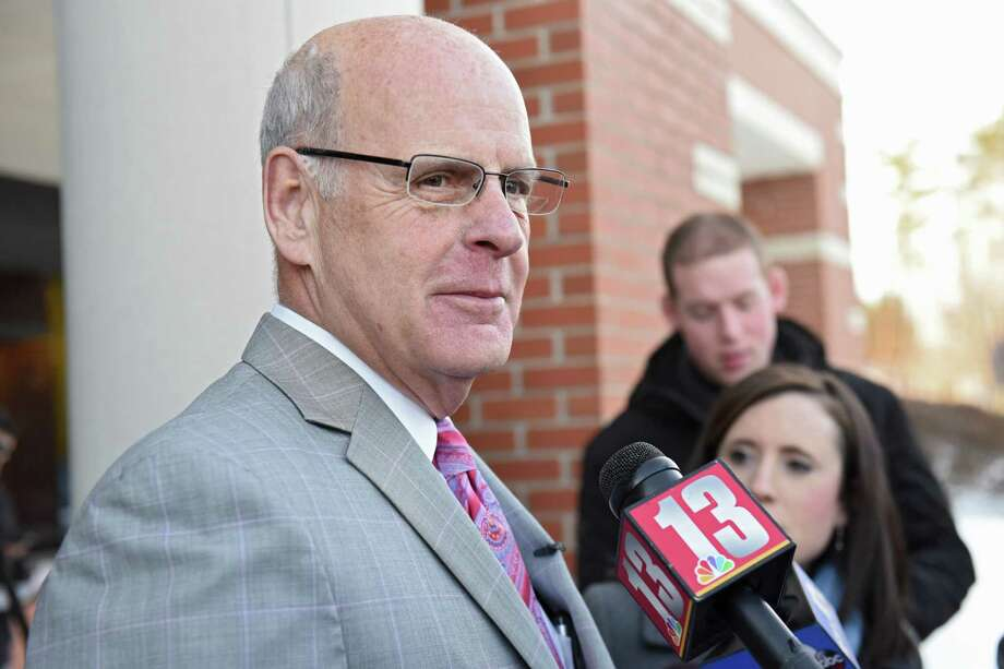 Troy police officer Kevin P. McKenna's attorney Stephen Coffey talks to the press as he leaves Colonie Town Court following McKenna's arraignment on Monday, March 20, 2017 in Colonie, N.Y. McKenna is charged with drunken driving and he's accused of crashing into a Colonie police van while off-duty. ( Lori Van Buren / Times Union) Photo: Lori Van Buren / 20040011A