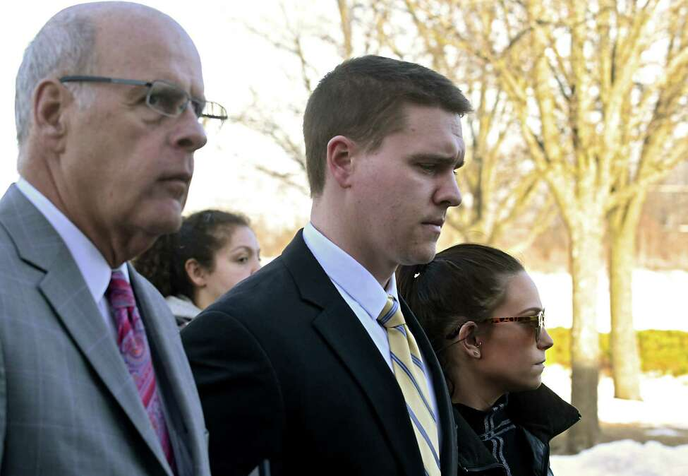 Troy police officer Kevin P. McKenna, center, shows up for his arraignment with his girlfriend and his attorney Stephen Coffey, left, at Colonie Town Court on Monday, March 20, 2017 in Colonie, N.Y. McKenna is charged with drunken driving and he's accused of crashing into a Colonie police van while off-duty. ( Lori Van Buren / Times Union)
