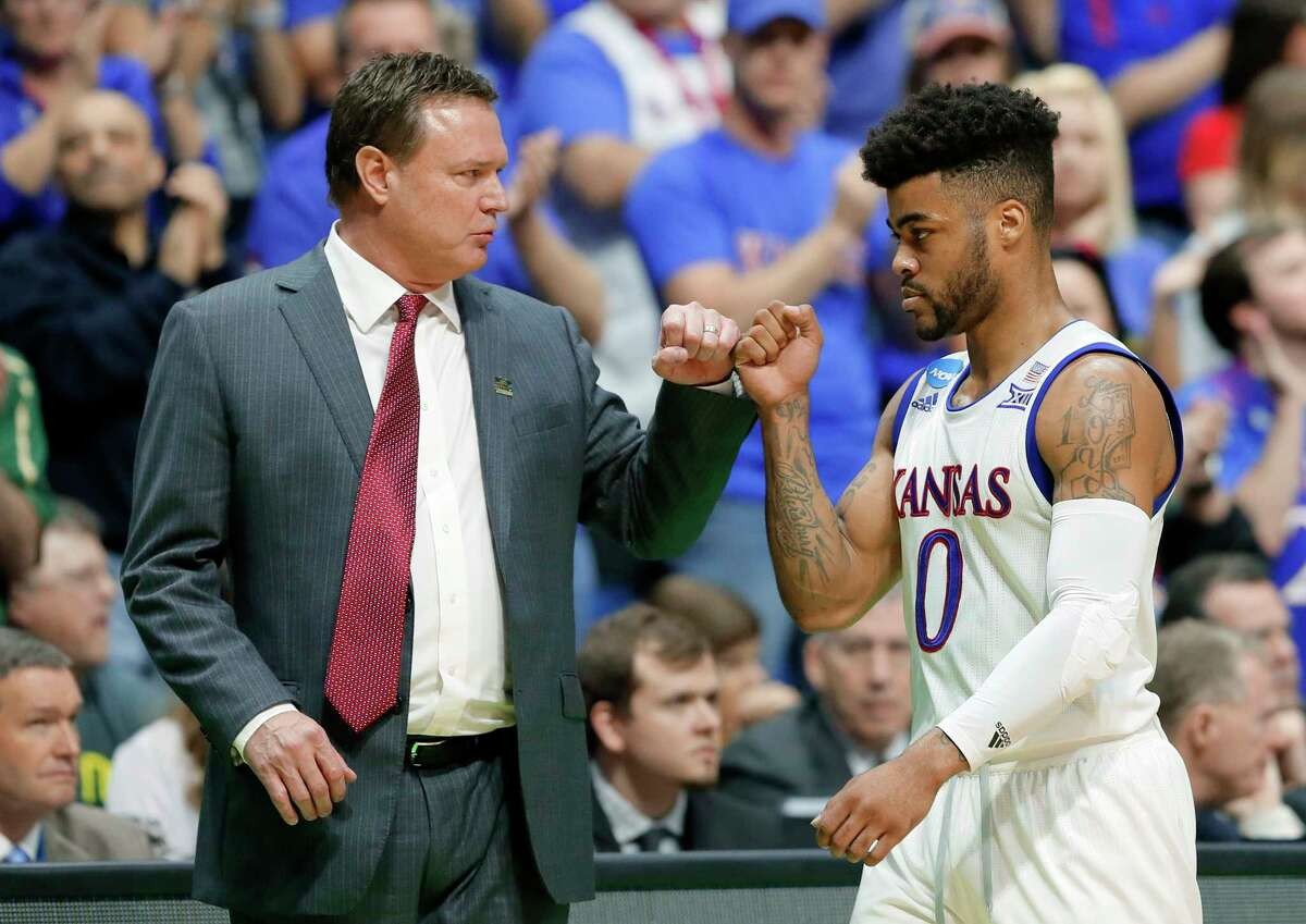 Kansas head coach Bill Self and guard Frank Mason III (0) greet each other at th bench in the closing seconds of the second half of a second-round game against Michigan State in the men's NCAA college basketball tournament in Tulsa, Okla., Sunday, March 19, 2017. (AP Photo/Tony Gutierrez) ORG XMIT: OKTG117