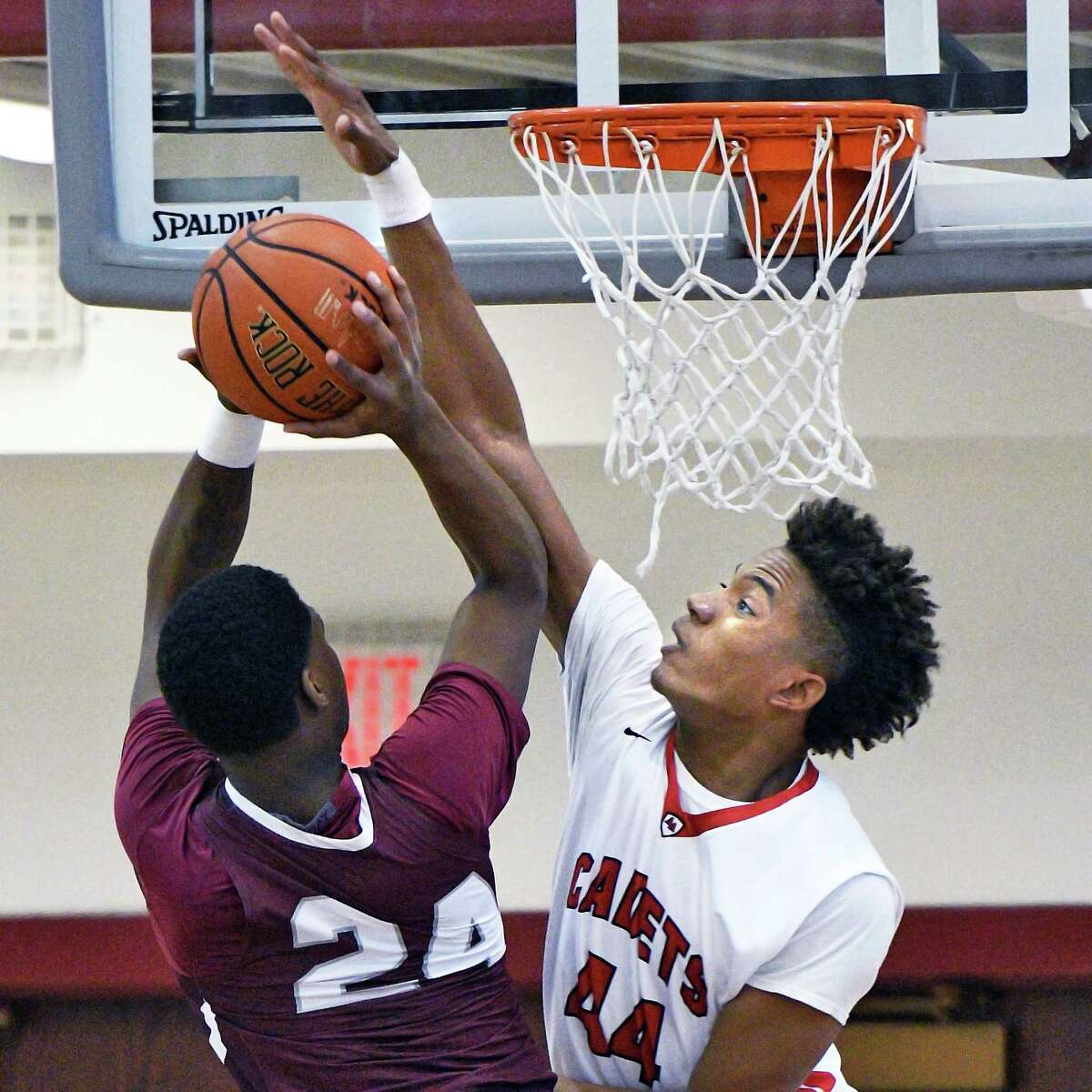 Lansingburgh's #24 Jahidi Wallace, left, is covered by Albany Academy's #44 Hameir Wright during Saturday's game at Vliet High Jan. 14, 2017 in Watervliet, NY. (John Carl D'Annibale / Times Union)