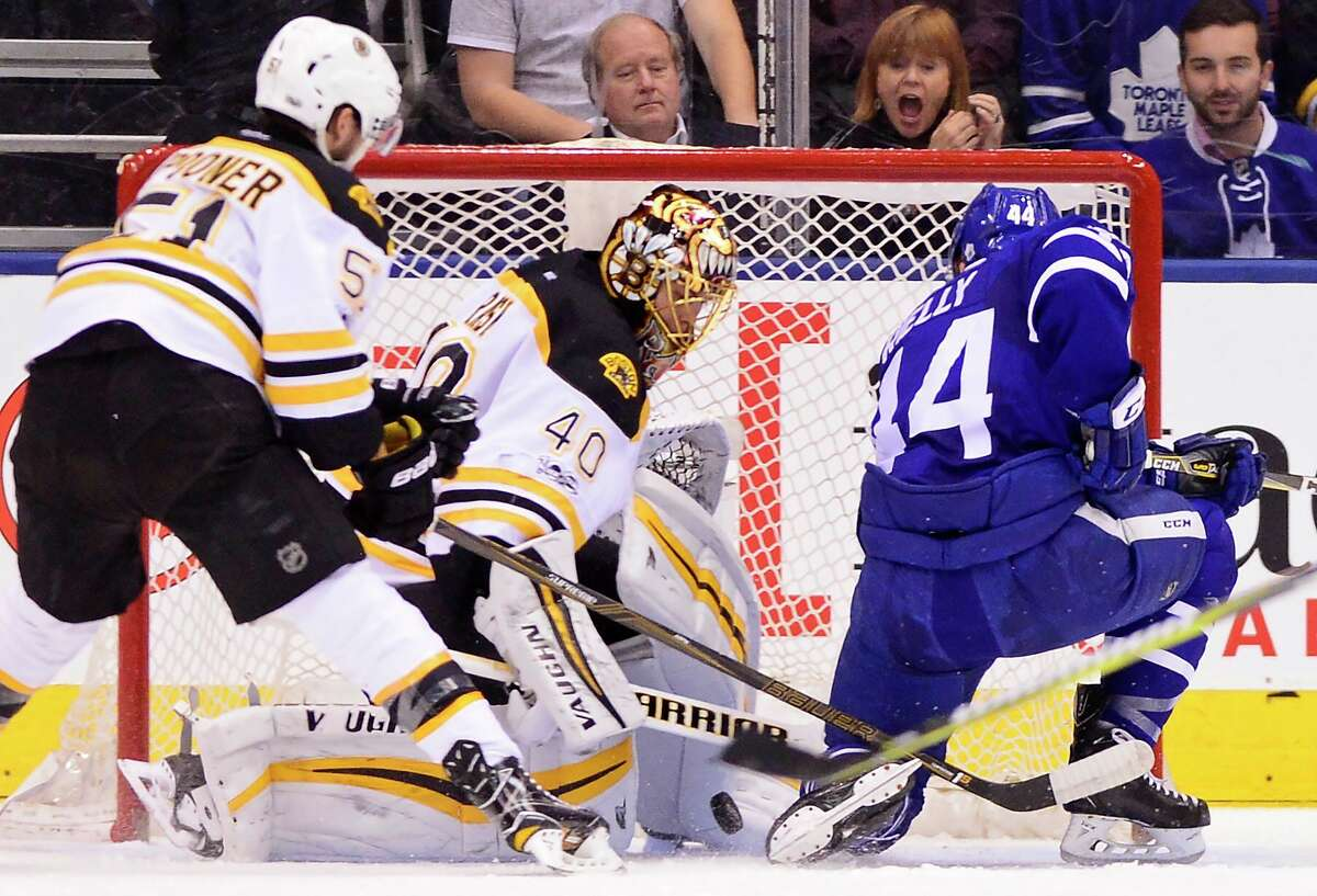Toronto Maple Leafs defenseman Morgan Rielly (44) scores on Boston Bruins goalie Tuukka Rask (40) as Bruins center Ryan Spooner (51) defends during the first period of an NHL hockey game Monday, March 20, 2017, in Toronto.(Frank Gunn/The Canadian Press via AP) ORG XMIT: FNG504