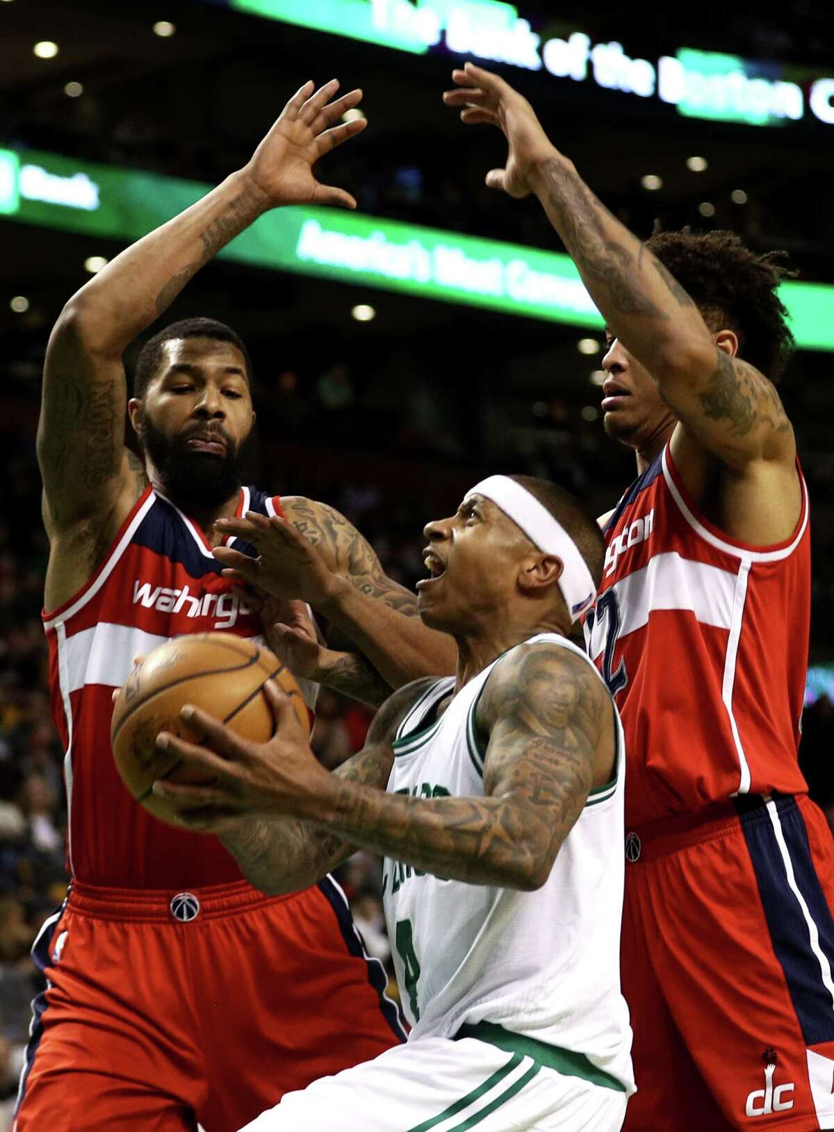 BOSTON, MA - MARCH 20: Isaiah Thomas #4 of the Boston Celtics takes a shot against Markieff Morris #5 of the Washington Wizards and Kelly Oubre Jr. #12 during the fourth quarter at TD Garden on March 20, 2017 in Boston, Massachusetts. The Celtics defeat the Wizards 110-102. NOTE TO USER: User expressly acknowledges and agrees that, by downloading and or using this Photograph, user is consenting to the terms and conditions of the Getty Images License Agreement. (Photo by Maddie Meyer/Getty Images) ORG XMIT: 662356973