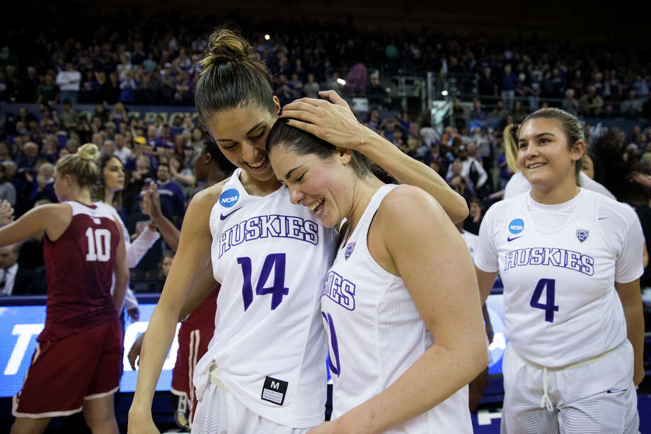UW's Kelsey Plum and Heather Corral celebrate the 108-82 win over Oklahoma in the second-round of the NCAA women's college basketball tournament Monday, March 20, 2017, at Alaska Airlines Arena in Seattle. Photo: GRANT HINDSLEY, SEATTLEPI.COM / SEATTLEPI.COM