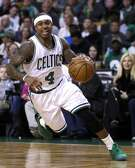 Boston Celtics guard Isaiah Thomas (4) drives to the basket during an NBA basketball game in Boston, Monday, March 20, 2017. The Celtics defeated the Wizards 110-102. (AP Photo/Charles Krupa)