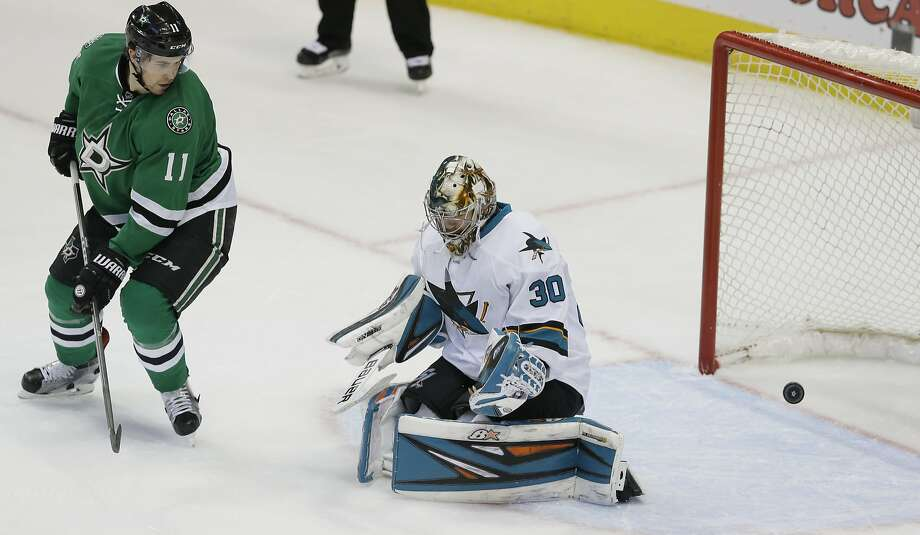 Dallas' Curtis McKenzie shoots past Sharks goalie Aaron Dell (30), the only goal the Stars would need for the win. Photo: LM Otero, Associated Press