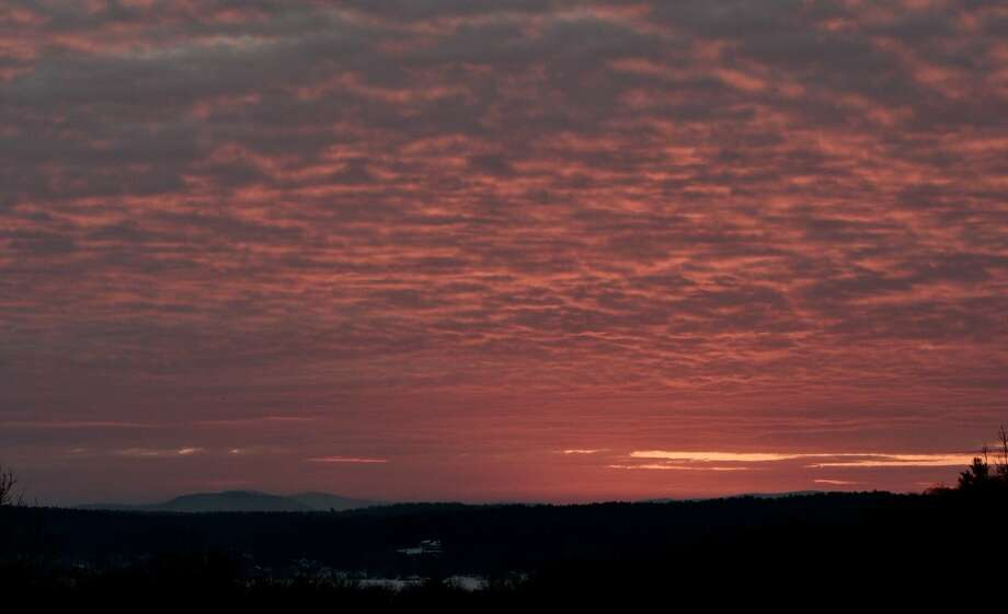 The sun rises over Saratoga Lake on Tuesday, March 21, 2017. (Skip Dickstein / Times Union) Photo: (Skip Dickstein / Times Union)