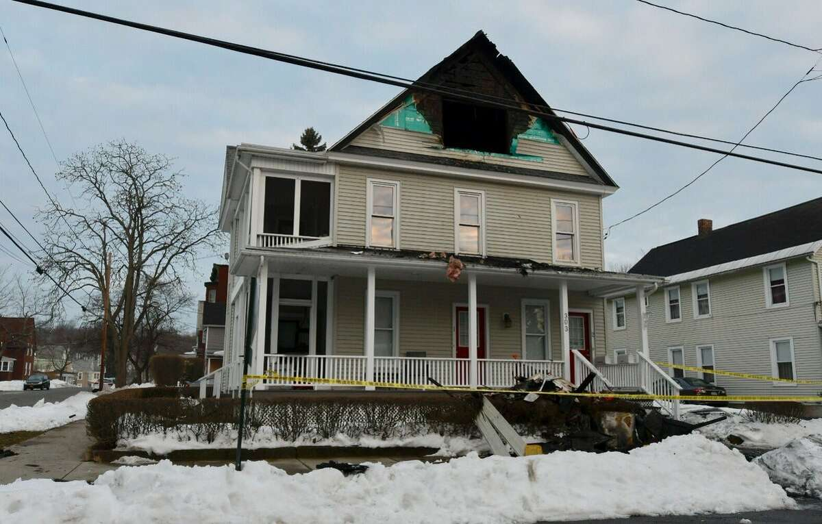 A powerful electrical fire displaced five people late Monday, March 20, 2017. The blaze also damaged the 303 N. Fourth Ave. home. (Skip Dickstein / Times Union)