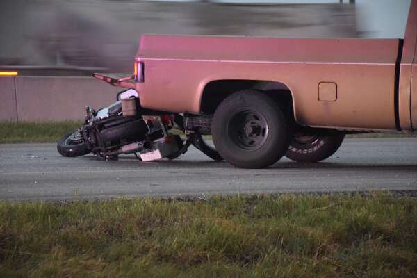 A motorcyclist suffered life-threatening injuries Tuesday morning after he drove into the back of a pickup truck on Loop 410 while trying to avoid an 18-wheeler.
