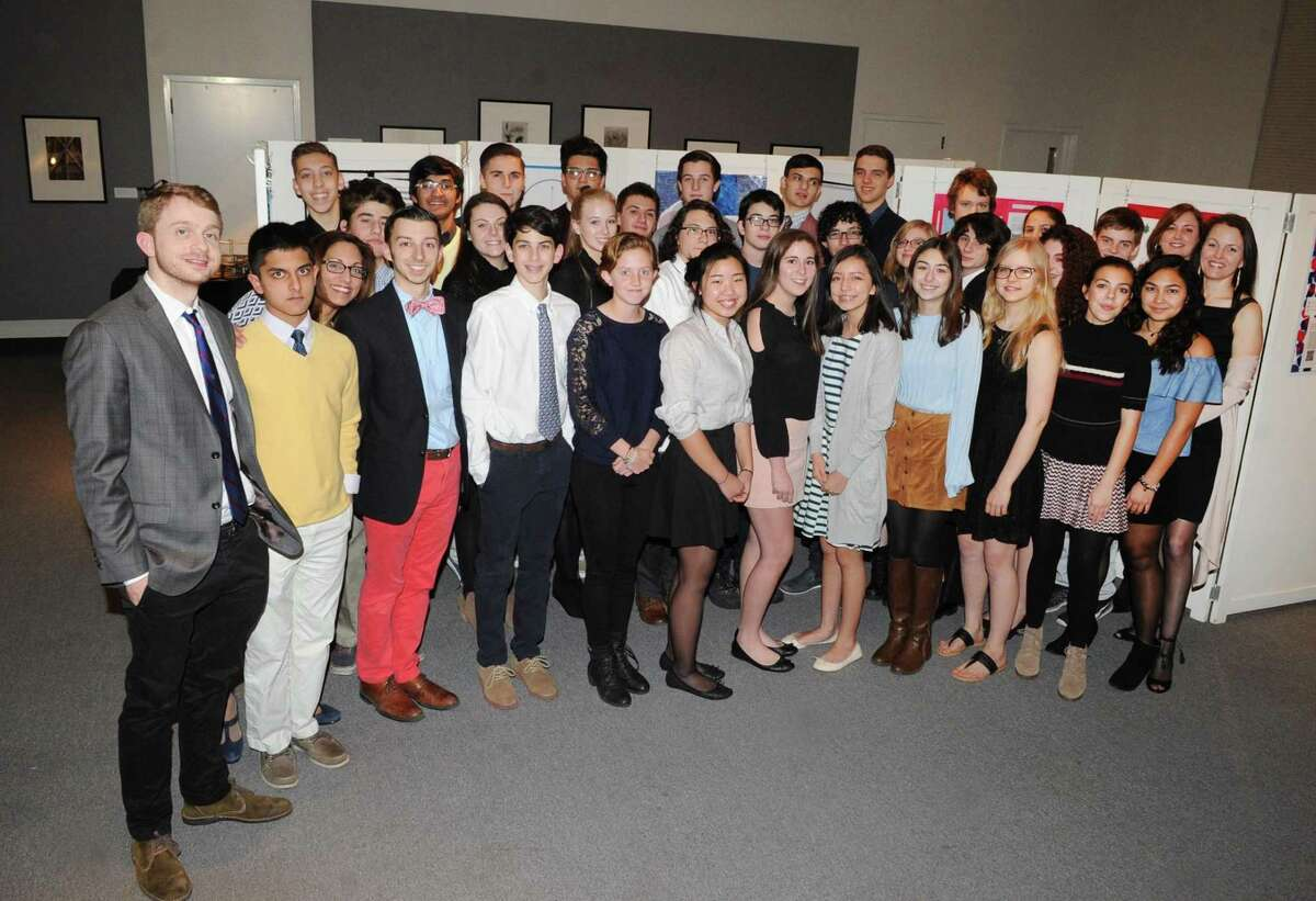 Sophomores from the Greenwich High School Innovation Lab program with their teachers during the Greenwich High School Innovation Lab exhibition at the Bruce Museum in Greenwich, Conn., Wednesday night, Feb. 8, 2017.