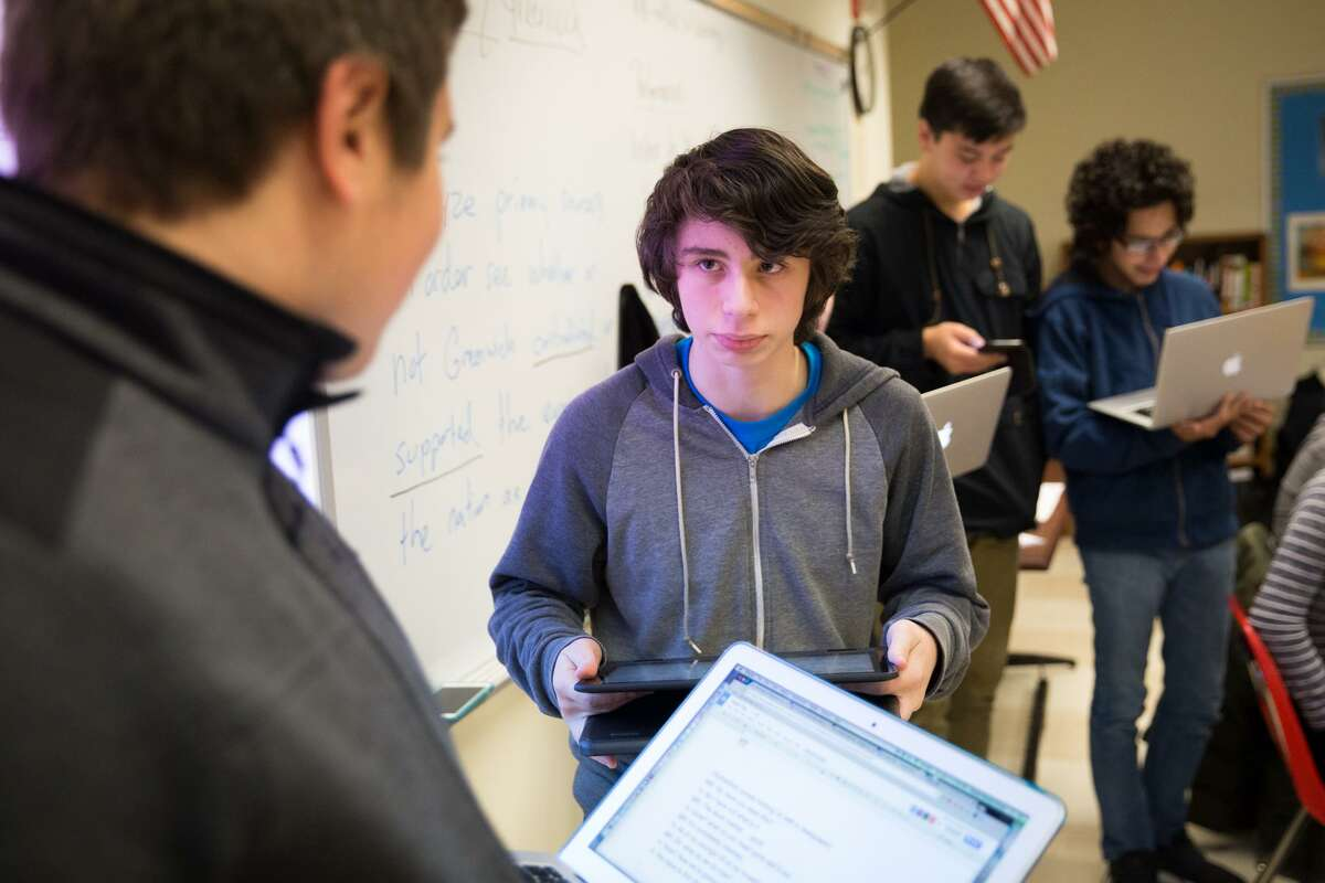 Ben Wolff performs a skit about Greenwich history alongside his classmates in the Greenwich High School Innovation Lab on Thursday, December 15, 2016.