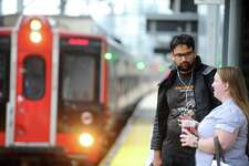 Bridgeport resident Tanmay Tiwari and Stamford resident Jenny Taylor chat while waiting for a train at the Stamford train station in downtown Stamford, Conn. on Monday, September 19, 2016.