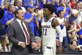After pouring in a game-high 23 points, Kansas' Josh Jackson gets a warm welcome from Kansas coach Bill Self as Jackson exits with the Jayhawks holding a 20-point lead over Michigan State on Sunday, March, 19, 2017 in the second round of the NCAA men's basketball tournament at the BOK Center in Tulsa, Okla. Kansas downed Michigan State 90-70. (Rich Sugg/Kansas City Star/TNS)