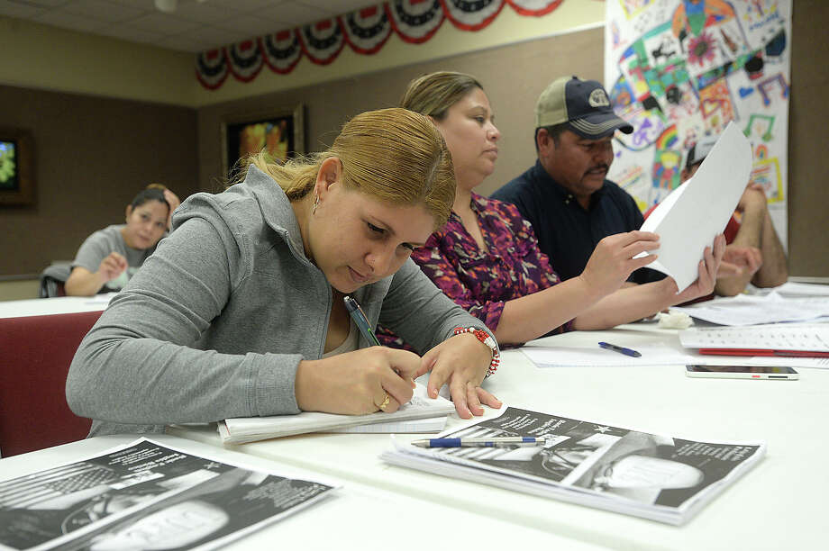 Diana Nunez, who came to the united States from Cuba, signs in during the free ESL classes led by Fernando Ramirez at the Port Arthur Public Library Tuesday night. Photo taken Tuesday, March 14, 2017 Kim Brent/The Enterprise Photo: Kim Brent, Beaumont Enterprise / BEN