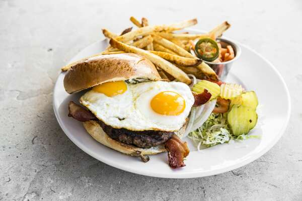 Burger with Two Cage-free Fried Eggs at Hungry's Upstairs, 2356 Rice Blvd. : Applewood-smoked bacon, lettuce, tomato, onion and mayo served with hand-cut fries. Available during Weekend Brunch only, Saturday and Sundays.