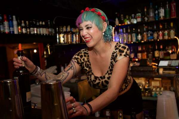 Andrea Jamison serves a drink at Gold Bar. Photo By: Xelina Flores