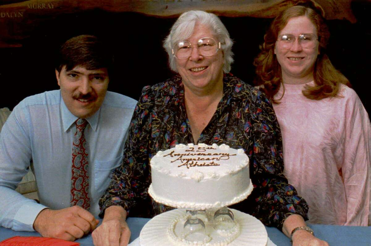FILE--Atheist Madalyn Murray O'Hair, center, sits with son, Jon, left, and granddaughter Robin Murray-O'Hair, adopted as her own daughter, in Austin, Texas, in this June 1988 file photo. Gary Karr, an ex-convict, was convicted of conspiring to rob Madalyn Murray O'Hair and her family, but was found innocent of kidnapping the three, who disappeared in 1995 and are believed to have been killed and dismembered. (AP Photo/David Breslauer, File)