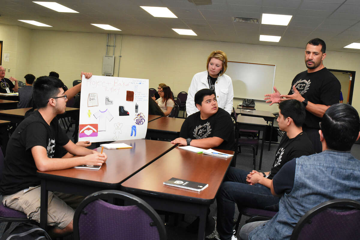 The Pace Plus class gathers in group sessions to work out team projects. Students Mario Perez, left, and Juan Ramirez listen to Oscar Lujan and Fabian Mandujano as Jenifer Rayphole and Felix Castillo help in the group discussion