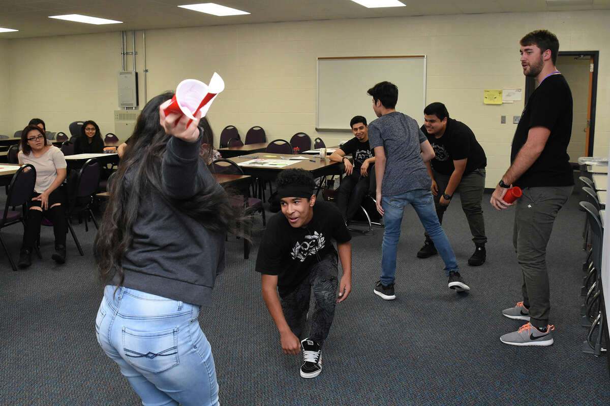 Pace Plus Class Feature The Jersey Village class for freshman is set up to help students explore their personal, academic and career path and to help the homeless. With help from CyHope volunteer. (Caption) (L front ) Aaliya Fuentes beat Shaun Spencer to the cup, the game is use to develop focus and speed. In the word association game, cup was the key word.