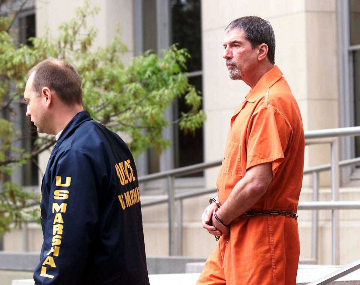 David Waters, right, the alleged mastermind behind the slaying of atheist activist Madalyn Murray O'Hair, and two of her family members, is escorted out of the Federal Courthouse in Austin, Texas, Friday, March 30, 2001, after being sentenced to 20 years in prison on a federal extortion charge. (AP Photo/Austin American-Statesman, Sung Park) HOUCHRON CAPTION (03/31/2001): Waters.