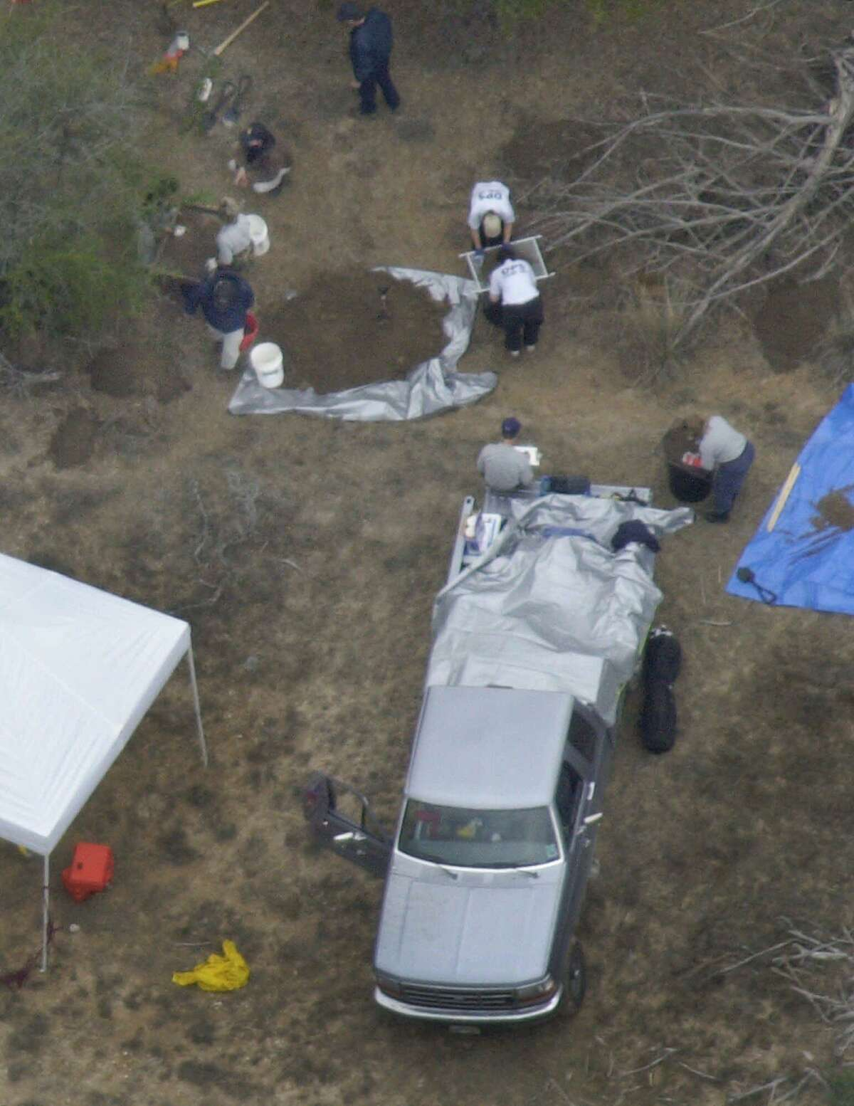 FILE--State and federal agents dig in a marked area on a remote South Texas ranch as they search for the remains of missing atheist leader Madalyn Murray O'Hair and her family near Camp Wood, Texas, in this Jan. 27, 2001 file photo. Federal authorities confirmed Thursday, March 15, 2001 that bones dug up from the ranch are those of Madalyn Murray O'Hair, 76, and her son Jon Garth Murray, 40, and Robin Murray O'Hair, 30, her granddaughter. The family disappeared from San Antonio in 1995 along with $500,000 in gold coins. Investigators believe they were kidnapped, robbed and killed, and their bodies were cut up and dumped on the ranch. (AP Photo/Eric Gay, File)
