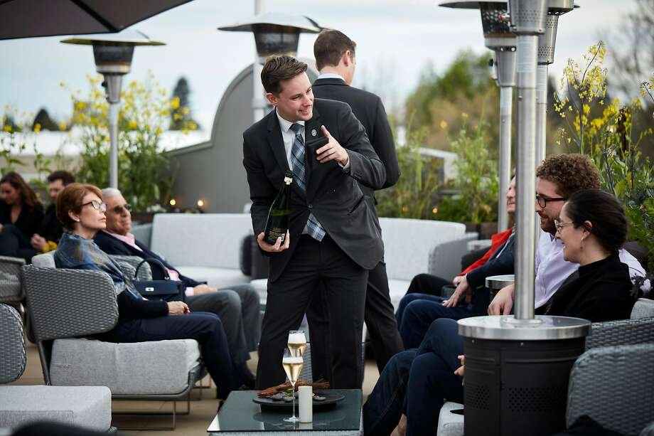 HEALDSBURG, CALIF - March 19, 2017: Sommelier Matt Dulle pours drinks for diners on the rooftop gardens at SingleThread Farms in Healdsburg. Photo: John Lee, Special To The Chronicle